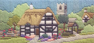 Click for more details of Church Lane (long-stitch) by Rose Swalwell