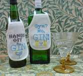 Click for more details of Gin Bottle Aprons - Gym and Hands Off (cross stitch) by Julie Lynes