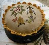 Click for more details of Queen Bee Pincushion (cross stitch) by Heartstring Samplery