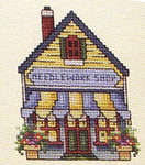 Click for more details of Spring in the Village (cross-stitch pattern) by Stoney Creek