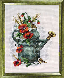 Poppies in watering can - click for larger image