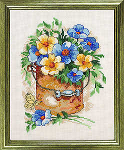 Blue and yellow flowers in a bucket - click for larger image