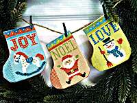 Click for more details of Gift Stocking Bunting (cross stitch) by Tiny Modernist