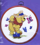 Click for more details of Pooh in the Garden (cross stitch) by Disney by Royal Paris