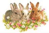 Click for more details of Rabbits in a Field of Flowers (cross stitch) by Vervaco