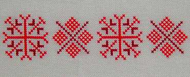 Click for more details of Red Snowflakes (cross stitch) by Anne Peden