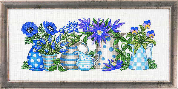 Blue flowers in blue jugs