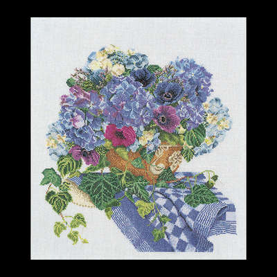 Blue Hydrangea and anemones on a blue table cover