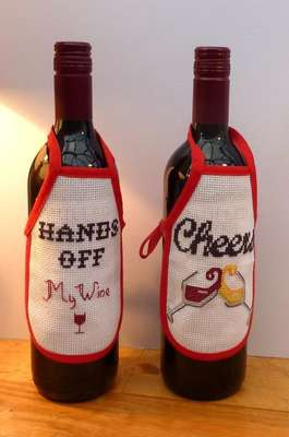 Wine Bottle Aprons, cross stitch kit by Julie Lynes, Arts and Designs